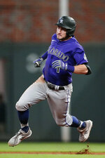 Colorado Rockies second baseman Garrett Hampson (1) rounds the bases on his way to a triple in the sixth inning of a baseball game against the Atlanta Braves Tuesday, Sept. 14, 2021, in Atlanta. (AP Photo/John Bazemore)
