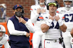Auburn head coach Gus Malzahn, left, and Auburn quarterback Cord Sandberg (24) look at the scoreboard during the first half of an NCAA college football game against Mississippi in Oxford, Miss., Saturday Oct. 24, 2020. (AP Photo/Rogelio V. Solis)