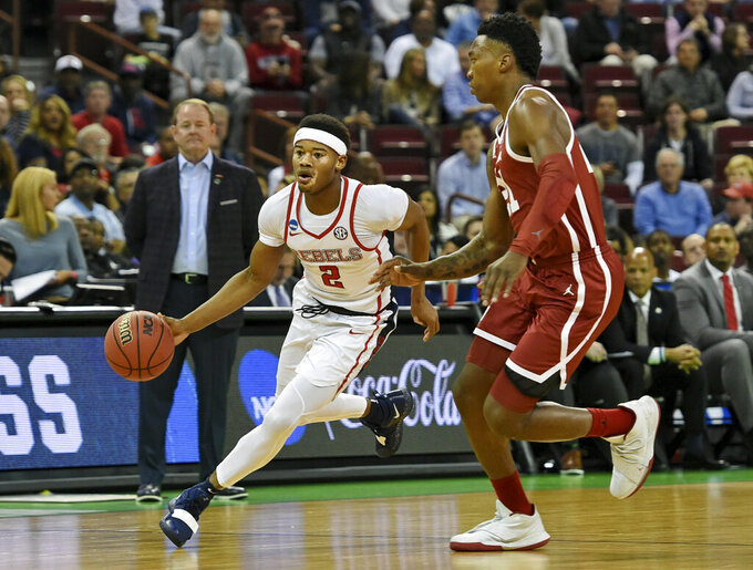 Mississippi's Devonte Shuler (2) drives up the court while defended by Oklahoma's Kristian Doolittle during a first round men's college basketball game in the NCAA Tournament in Columbia, S.C. Friday, March 22, 2019. (AP Photo/Richard Shiro)