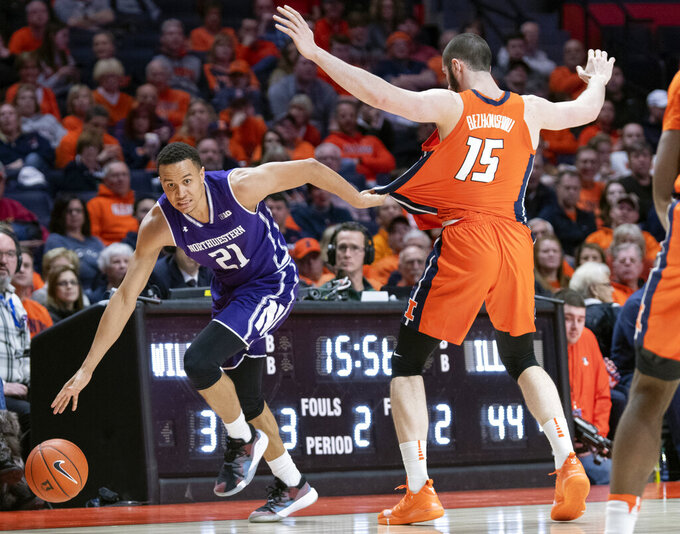 FILE - In this March 3, 2019, file photo, Northwestern forward A.J. Turner (21) moves the ball along the sideline past Illinois forward Giorgi Bezhanishvili (15) during the second half of an NCAA college basketball game in Champaign, Ill. Northwestern hopes to find its footing coming off back-to-back losing seasons since the school that hosted the NCAA's inaugural Final Four made the tournament for the first time. (AP Photo/Stephen Haas, File)