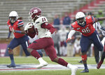 New Mexico State running back Christian Gibson carries the ball during an NCAA college football game against  Liberty in Lynchburg, Va., on  Saturday, Nov. 30, 2019. (Taylor Irby/ News & Advance via AP)