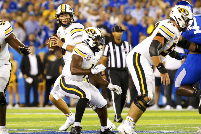 Missouri quarterback Connor Bazelak (8) looks for an open receiver during the first half of an NCAA college football game against Missouri in Lexington, Ky., Saturday, Sept. 11, 2021. (AP Photo/Michael Clubb)