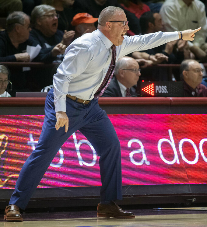 Virginia Tech head coach Buzz Williams yells to his players against Louisville during the second half of an NCAA college basketball game, Monday, Feb. 4, 2019, in Blacksburg, Va. Louisville won 72-64. (AP Photo/Don Petersen)