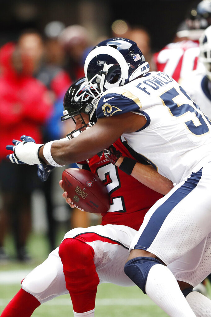 Los Angeles Rams defensive end Dante Fowler (56) hits Atlanta Falcons quarterback Matt Ryan (2) during the first half of an NFL football game, Sunday, Oct. 20, 2019, in Atlanta. (AP Photo/John Bazemore)