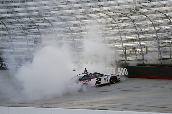 Brad Keselowski (2) does a burnout after winning after winning a NASCAR Cup Series auto race at Bristol Motor Speedway Saturday, May 30, 2020, in Bristol, Tenn. (AP Photo/Mark Humphrey)