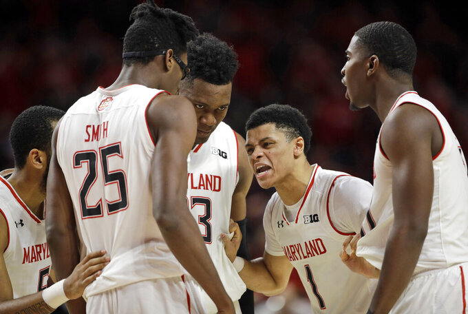 FILE - In this Tuesday, Feb. 12, 2019, file photo, Maryland guard Anthony Cowan Jr. (1) huddles with teammates, from left, Eric Ayala, Jalen Smith, Bruno Fernando and Darryl Morsell during the second half of an NCAA college basketball game against Purdue in College Park, Md. Extremely young and doggedly determined, Maryland has used a long-awaited growth spurt to move into the upper tier of the Big Ten standings(AP Photo/Patrick Semansky, File)