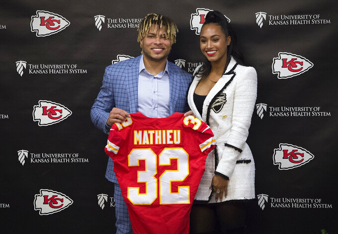 Kansas City Chiefs new safety Tyrann Mathieu poses with his longtime girlfriend Sydni Paige Russell during an NFL football news conference Thursday, March 14, 2019 at the team's practice facility in Kansas City, Mo. (Tammy Ljungblad/The Kansas City Star via AP)