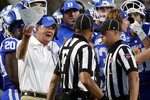 Duke head coach David Cutcliffe, left, confers with officials as a fourth down play is reviewed during the second half of an NCAA college football game against Northwestern in Durham, N.C., Saturday, Sept. 18, 2021. The ruling on the field was a first down, but on review the play was overturned and Northwestern took over on downs. (AP Photo/Chris Seward)