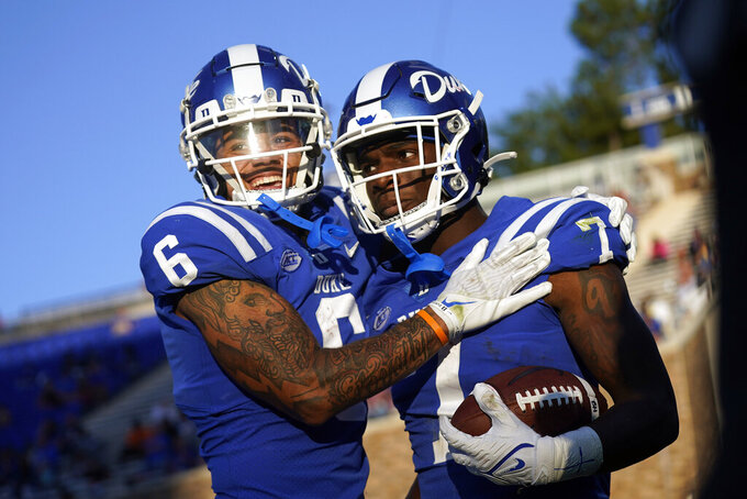Duke wide receiver Eli Pancol (6) congratulates running back Jordan Waters (7) following Waters' touchdown against Kansas during the second half of an NCAA college football game in Durham, N.C., Saturday, Sept. 25, 2021. (AP Photo/Gerry Broome)