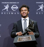 Oklahoma quarterback Kyler Murray poses with the Heisman Trophy after winning the award Saturday, Dec. 8, 2018, in New York. (AP Photo/Craig Ruttle)