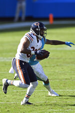 Chicago Bears defensive back DeAndre Houston-Carson (36) runs the ball following an interception against the Carolina Panthers during the second half of an NFL football game in Charlotte, N.C., Sunday, Oct. 18, 2020. (AP Photo/Mike McCarn)