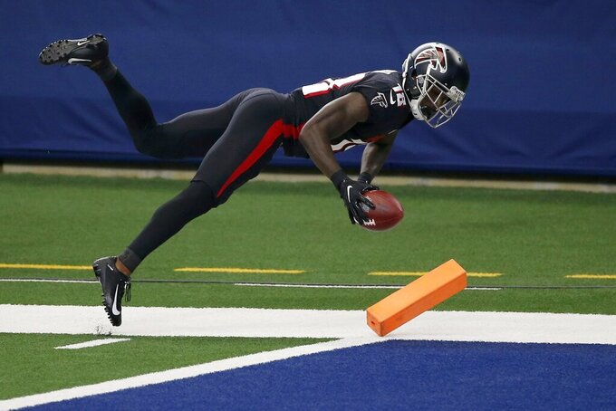 Atlanta Falcons wide receiver Calvin Ridley leaps into the zone after catching a pass to score a touchdown in the first half of an NFL football game against the Dallas Cowboys in Arlington, Texas, Sunday, Sept. 20, 2020. (AP Photo/Ron Jenkins)