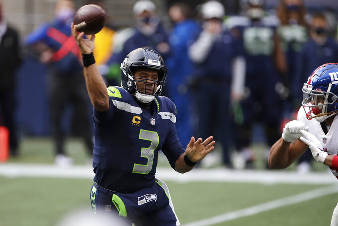 Seattle Seahawks quarterback Russell Wilson passes against the New York Giants during the first half of an NFL football game, Sunday, Dec. 6, 2020, in Seattle. (AP Photo/Larry Maurer)