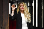 Amber Heard arrives at High Court in London, Monday, July 27, 2020. Hollywood actor Johnny Depp is suing News Group Newspapers over a story about his former wife Amber Heard, published in The Sun in 2018 which branded him a 'wife beater', a claim he denies. (AP Photo/Alberto Pezzali)