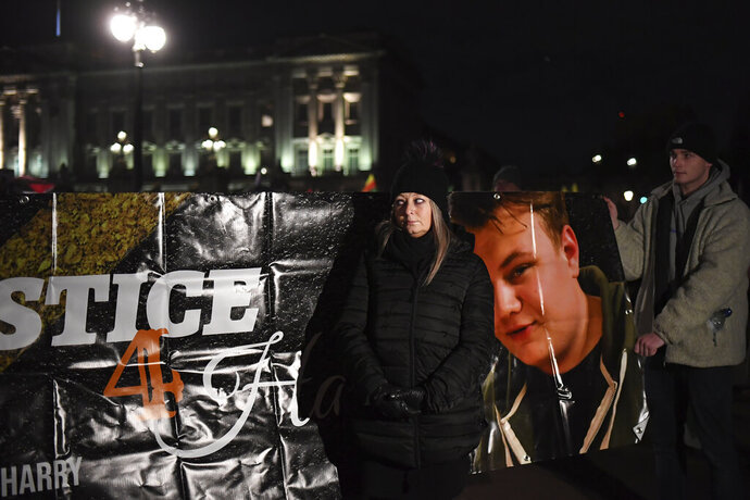 Charlotte Charles, center, the mother of Harry Dunn who was killed in a crash by the wife of a U.S. diplomat, takes part in a demonstration against NATO and U.S. President Donald Trump's visit, in London, Tuesday, Dec. 3, 2019. Trump and his NATO counterparts were gathering in London Tuesday to mark the alliance's 70th birthday amid deep tensions as spats between leaders expose a lack of unity that risks undermining military organization's credibility. (AP Photo/Alberto Pezzali)