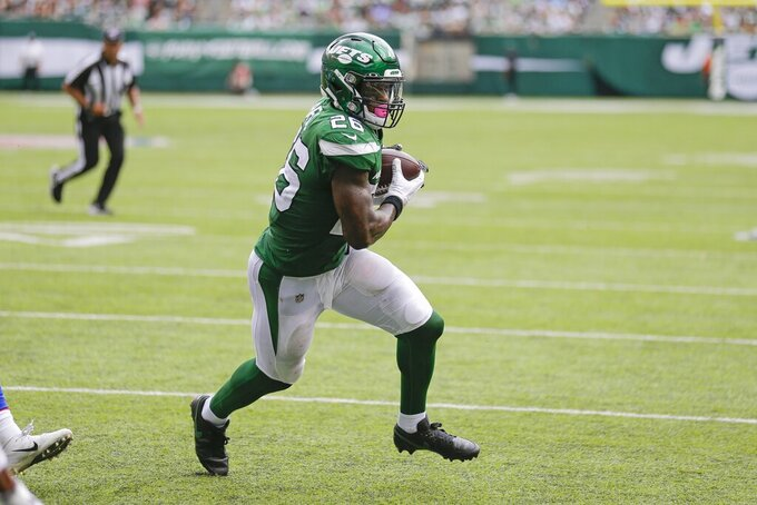 New York Jets' Le'Veon Bell (26) rushes for a touchdown during the second half of an NFL football game against the Buffalo Bills Sunday, Sept. 8, 2019, in East Rutherford, N.J. (AP Photo/Seth Wenig)