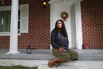 Dayja Hogg, 19, sits for a portrait in front of her home on Wednesday, Sept. 16, 2020, in Whitesburg, Ky. Following the deaths of George Floyd in Minneapolis and Breonna Taylor in Louisville, Hogg helped organize a protest in her home town of Whitesburg where she grew up experiencing racism. (AP Photo/Brian Blanco)