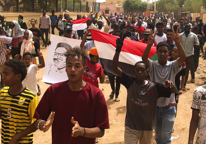 Sudanese protesters shout slogans during a demonstration against the ruling military council, in Khartoum, Sudan, Sunday, June 30, 2019. Tens of thousands of protesters took to the streets on Sunday in Sudan's capital and elsewhere in the country calling for civilian rule, nearly three months after the army forced out the autocrat Omar al-Bashir. (AP Photo/Hussein Malla)