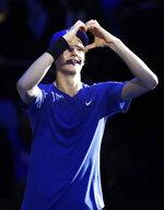 Jannik Sinner of Italy, celebrates after winning the ATP Next Gen tennis tournament semifinal match against Miomir Kecmanovic of Serbia,in Milan, Italy, Friday, Nov. 8, 2019. (AP Photo/Luca Bruno)