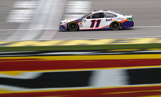 Denny Hamlin (11) drives during qualifying for the NASCAR Cup Series auto race at Las Vegas Motor Speedway, Friday, March 1, 2019, in Las Vegas. (AP Photo/John Locher)