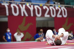 Kang Yujeong of South Korea reacts after her match against Marusa Stangar of Slovenia during the women's 48kg round of 32 judo competition at the 2020 Summer Olympics, Saturday, July 24, 2021, in Tokyo, Japan. (AP Photo/Vincent Thian)
