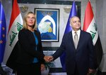 Iraqi Foreign Minister Mohamed Alhakim, right, shakes hands with visiting European Union foreign policy chief Federica Mogherini before their meeting at the Ministry of Foreign Affairs in Baghdad, Iraq, Saturday, July 13, 2019. (AP Photo/Hadi Mizban)