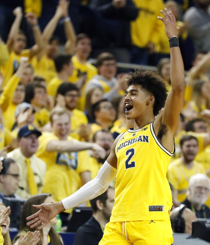 Michigan guard Jordan Poole acknowledges the fans in the closing seconds of the team's NCAA college basketball game against Ohio State, Tuesday, Jan. 29, 2019, in Ann Arbor, Mich. (AP Photo/Carlos Osorio)