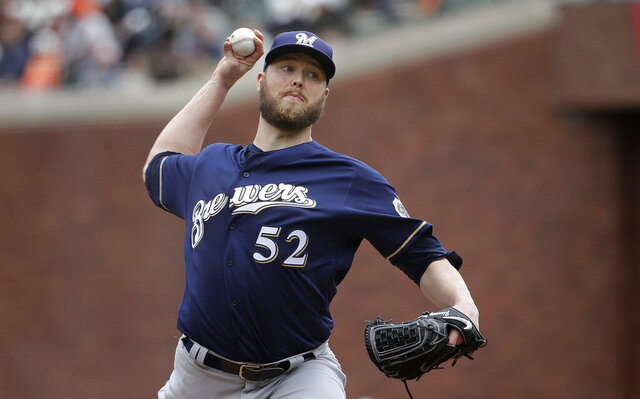 FILE - In this Saturday, June 15, 2019 file photo, Milwaukee Brewers pitcher Jimmy Nelson (52) throws to a San Francisco Giants batter during the second inning of a baseball game in San Francisco. Right-hander Jimmy Nelson and the Los Angeles Dodgers agreed Tuesday, Jan. 7, 2020 to a $1.25 million, one-year contract, an incentive-laden deal that could be worth $13.25 million over two seasons.(AP Photo/Jeff Chiu, File)