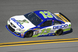 "FILE - In this Feb. 19, 2017, file photo, Ty Dillon (13) drives through Turn 4 during a qualifying run for the NASCAR Daytona 500 auto race at Daytona International Speedway in Daytona Beach, Fla. NASCAR has signed Busch Beer, Coca-Cola, Geico and Xfinity as its ""premier partners"" in a change to its traditional sponsorship model. The premier series starting next year will be known as the NASCAR Cup Series and not feature a title sponsor.  (AP Photo/Phelan M. Ebenhack, File)"