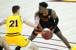 Oregon State forward Warith Alatishe (10) looks to pass as Arizona State forward Chris Osten (21) defends during the first half of an NCAA college basketball game, Sunday, Feb. 14, 2021, in Tempe, Ariz.(AP Photo/Matt York)