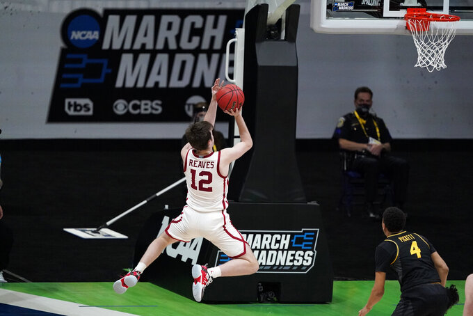 Oklahoma guard Austin Reaves (12) drives to the basket over Missouri guard Javon Pickett (4) during the second half of a first-round game in the NCAA men's college basketball tournament at Lucas Oil Stadium, Saturday, March 20, 2021, in Indianapolis. (AP Photo/Darron Cummings)