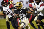 FILE - In this Nov. 28, 2020, file photo, Colorado running back Jarek Broussard, front, runs for a short gain as San Diego State linebacker Andrew Aleki pursues during the second half of an NCAA college football game in Boulder, Colo. Broussard was selected as the PAC-12 offensive player of the year along with Oregon State running back Jermar Jefferson.  (AP Photo/David Zalubowski, File)