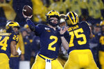 Michigan quarterback Shea Patterson (2) throws against Notre Dame in the first half of an NCAA college football game in Ann Arbor, Mich., Saturday, Oct. 26, 2019. (AP Photo/Paul Sancya)