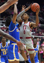 Stanford forward KZ Okpala (0) shoots as UCLA center Moses Brown (1) defends during the second half of an NCAA college basketball game Saturday, Feb. 16, 2019, in Stanford, Calif. (AP Photo/Tony Avelar)