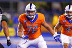 FILE - In this Oct. 12, 2019, file photo, Boise State offensive lineman Ezra Cleveland (76) is shown during the first half of an NCAA college football game against Hawaii in Boise, Idaho. Cleveland is a possible pick in the NFL Draft which runs Thursday, April 23, 2020, thru Saturday, April 25. (AP Photo/Steve Conner, File)