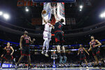 Philadelphia 76ers' Mike Scott (1) tries to dunk against Chicago Bulls' Luke Kornet (2) during the first half of an NBA basketball game, Friday, Jan. 17, 2020, in Philadelphia. (AP Photo/Matt Slocum)