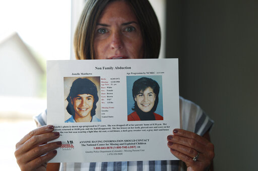 FILE - In this Aug. 12, 2019, file photo, Jennifer Mogensen holds a poster of her adopted sister, Jonelle Matthews, who went missing and whose remains were found recently in Greeley, Colo. The trial for Steve Pankey, a former longshot candidate for Idaho governor who has been indicted in the murder of Jonelle Matthews, is set to begin Wednesday, Oct. 13, 2021. (AP Photo/David Zalubowski, File)