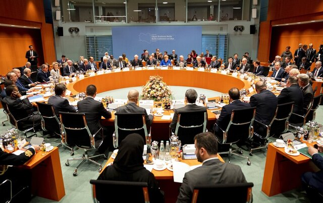 German Chancellor Angela Merkel, rear center, leads a conference on Libya at the chancellery in Berlin, Germany, Sunday, Jan. 19, 2020. (Kay Nietfeld/DPA via AP, Pool)