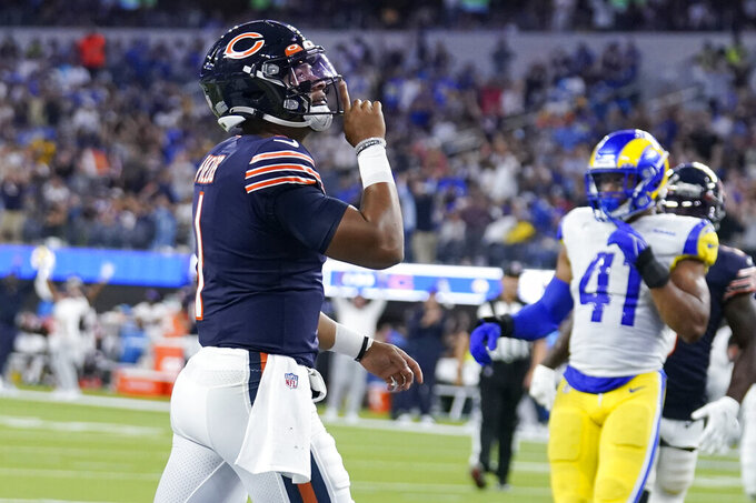 Chicago Bears quarterback Justin Fields reacts after scoring a touchdown during the second half of an NFL football game against the Los Angeles Rams, Sunday, Sept. 12, 2021, in Inglewood, Calif. (AP Photo/Marcio Jose Sanchez)