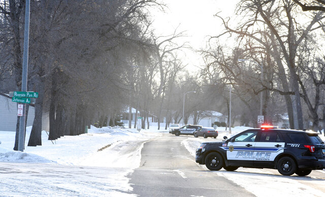 Police control access to the 100 block of Riverside Park Road in Bismarck, N.D., on Friday, Jan. 10, 2020 after a member of the West Dakota SWAT shot and killed a 30-year-old man during a stand-off late Thursday night. (Mike McCleary/The Bismarck Tribune via AP)