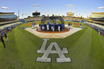 Members of the Los Angeles Dodgers practice for Game 1 of the NLDS baseball game against the Washington Nationals Wednesday, Oct. 2, 2019, in Los Angeles. (AP Photo/Mark J. Terrill)