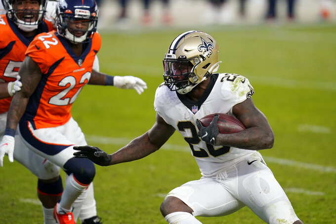 New Orleans Saints running back Latavius Murray (28) runs for a touchdown as Denver Broncos strong safety Kareem Jackson (22) looks on during the second half of an NFL football game, Sunday, Nov. 29, 2020, in Denver. (AP Photo/David Zalubowski)