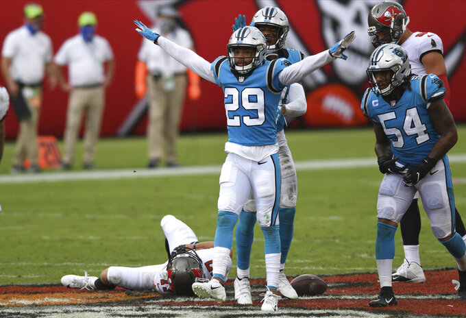 Carolina Panthers cornerback Corn Elder (29) celebrates after stopping Tampa Bay Buccaneers wide receiver Justin Watson (17) during the second half of an NFL football game Sunday, Sept. 20, 2020, in Tampa, Fla. (AP Photo/Jason Behnken)
