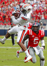 Auburn wide receiver Darius Slayton (81) spins in the air after catching a pass against the defense of Mississippi defensive back Ken Webster (5) during the first half of an NCAA college football game, Saturday, Oct. 20, 2018, in Oxford, Miss. (AP Photo/Rogelio V. Solis)