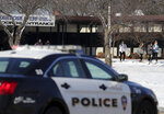 FILE - In this Dec. 3, 2019 file photo, students are evacuated from the scene of an officer involved shooting at Oshkosh West High School after an armed student confronted a school resource officer in Oshkosh, Wis. The involvement of school resource officers in two separate student shootings this week in Wisconsin highlights the role they can play in a worst-case scenario. While the thousands of officers in schools are dedicated to law enforcement first, they spend much of their days as counselors and educators. In cases of real and immediate threats to students or teachers, however, the rules on use of force are set by the police departments that assign them to the schools. (Wm. Glasheen/The Post-Crescent via AP, File)