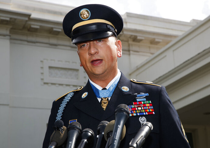 FILE - In this Tuesday, June 25, 2019, file photo, Medal of Honor recipient Army Staff Sgt. David Bellavia speaks to media outside the West Wing of the White House in Washington, after receiving the Medal of Honor for conspicuous gallantry while serving in support of Operation Phantom Fury in Fallujah, Iraq. Bellavia says he will not run for the 27th Congressional District seat recently vacated by Chris Collins. (AP Photo/Carolyn Kaster, File)