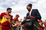 Iowa State defensive end Eyioma Uwazurike high fives fans as the team arrives to play South Dakota State in an NCAA college football game, Saturday, Sept. 1, 2018, in Ames, Iowa. (AP Photo/Matthew Putney)