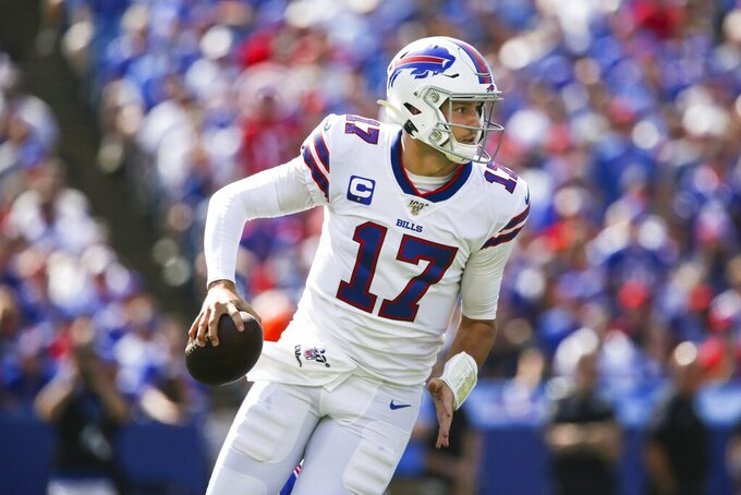 CORRECTS DATE - Buffalo Bills quarterback Josh Allen (17) looks to pass during the first half of an NFL football game against the Cincinnati Bengals, Sunday, Sept. 22, 2019, in Orchard Park, N.Y. (AP Photo/John Munson)