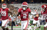 Oklahoma wide receiver CeeDee Lamb (2) runs upfield with a reception during the first half of an NCAA college football game against Baylor for the Big 12 Conference championship, Saturday, Dec. 7, 2019, in Arlington, Texas. (AP Photo/Jeffrey McWhorter)