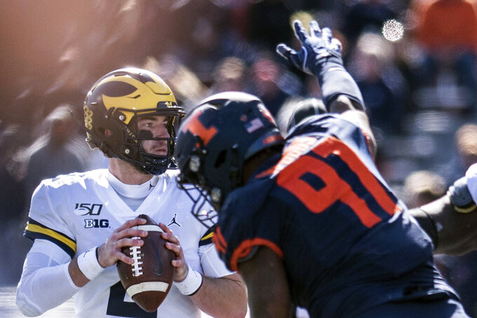 No. 16 Michigan needs late surge to beat Illinois 42-25